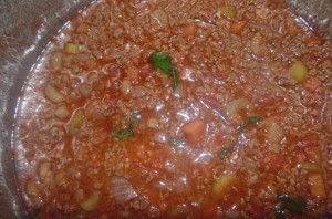 The Bolognese Sauce bubbling in the pan before the pasta is added