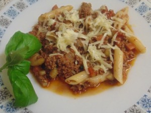 The Bolognese Sauce served with Pene Pasta and topped with Cheddar Cheese