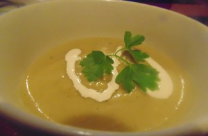 Leek and Potato Soup with a Swirl of Cream and Parsley Leaf