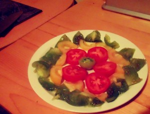 Heirloom Tomato Salad, on the plate before adding the Salsa Verde and Balsamic and Honey dressing