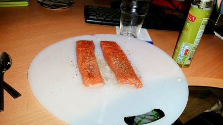 Cajun Salmon on a Mediterranean Sauce - Season the salmon with salt and pepper and spray oil over them