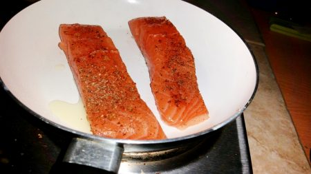 Cajun Salmon on a Mediterranean Sauce - Place the fish in a boiling hot pan