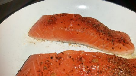 Cajun Salmon on a Mediterranean Sauce - Cook the fish skinned side down