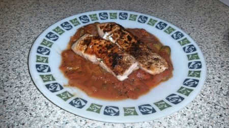 Cajun Salmon on a Mediterranean Sauce - Put the salmon on the sauce